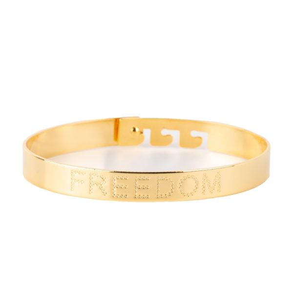 Cuff Freedom de bronce con baño de oro amarillo 18k.